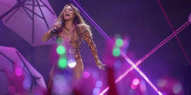 MIAMI, FL - JULY 18: Jennifer Lopez performs onstage during the Premios Juventud 2013 at Bank United Center on July 18, 2013