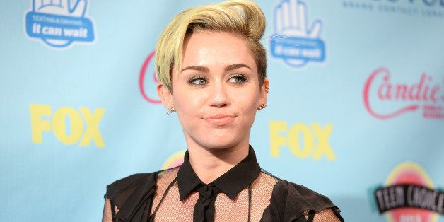 UNIVERSAL CITY, CA - AUGUST 11:  Singer/Actress Miley Cyrus, winner of Choice Summer Song for  We Cant Stop, Choice Female TV