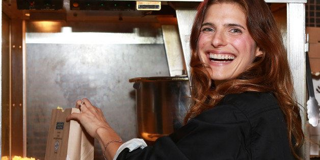 NEW YORK, NY - AUGUST 09:  Actress/director Lake Bell (R) serves popcorn at the  'In A World...' New York Screening at Landma