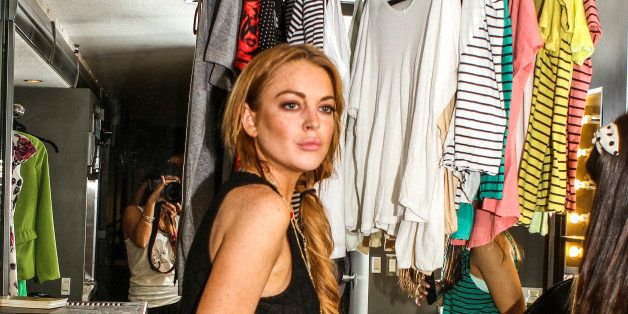 UNSPECIFIED LOCATION - APRIL 14:  In this handout photo provided by Kari Feinstein PR, Lindsay Lohan grabbing Dope clothing a