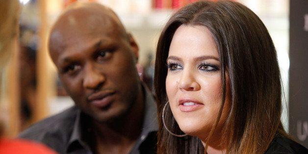 ORANGE, CA - JUNE 07:  Professional basketball player Lamar Odom and TV personality Khloe Kardashian make an appearance to pr
