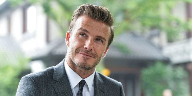 HANGZHOU, CHINA - JUNE 22: (CHINA OUT) David Beckham looks on as he visits Xijin Park on June 22, 2013 in Hangzhou, Zhejiang