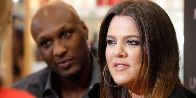 ORANGE, CA - JUNE 07:  Professional basketball player Lamar Odom and TV personality Khloe Kardashian make an appearance to pr