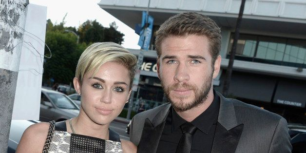 LOS ANGELES, CA - AUGUST 08:  Actress Miley Cyrus and actor Liam Hemsworth attend the premiere of Relativity Media's 'Paranoi