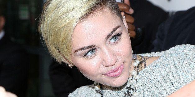 PARIS, FRANCE - SEPTEMBER 09:  Singer Miley Cyrus is seen leaving the 'NRJ' radio station on September 9, 2013 in Paris, Fran