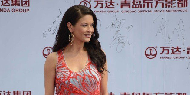 Actress Catherine Zeta-Jones of Britain poses during a red carpet event during a groundbreaking ceremony for the ambitious 'O