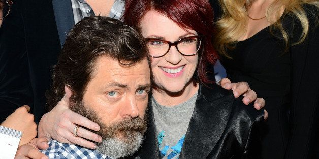 HOLLYWOOD, CA - MAY 28:  Actors Nick Offerman (L) and  Megan Mullally arrive at the screening of CBS Films' 'The Kings of Sum