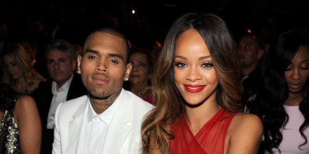 LOS ANGELES, CA - FEBRUARY 10:  Chris Brown and Rihanna attend the 55th Annual GRAMMY Awards at STAPLES Center on February 10