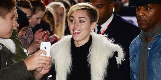 LONDON, UNITED KINGDOM - NOVEMBER 12: Miley Cyrus sighted arriving at BBC Radio One on November 12, 2013 in London, England.