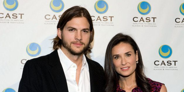 LOS ANGELES, CA - MAY 12:  Actor Ashton Kutcher (L) and actress Demi Moore arrive at the Coalition to Abolish Slavery & Traff