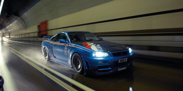 UNITED KINGDOM - OCTOBER 25: A modified Nissan Skyline car, driving through a tunnel. During a shoot for Fast Car Magazine, O