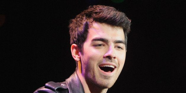 CHICAGO, IL - DECEMBER 14:  Joe Jonas performs during the B96 Pepsi Jingle Bash at Allstate Arena on December 14, 2013 in Chi
