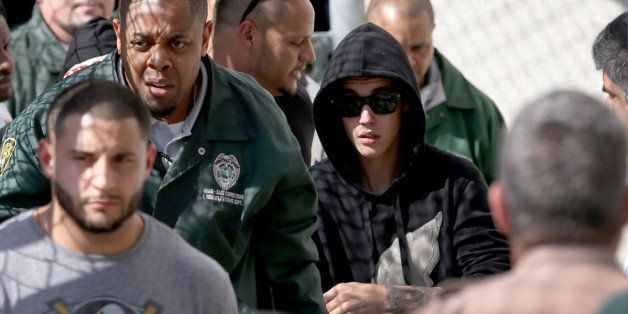 MIAMI, FL - JANUARY 23:  Justin Bieber (R) exits from the Turner Guilford Knight Correctional Center on January 23, 2014 in M