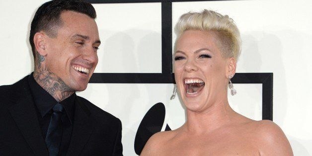 Motorcycle racer Carey Hart and singer Pink arrive on the red carpet for the 56th Grammy Awards at the Staples Center in Los