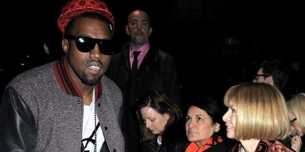 PARIS - MARCH 08:  Kanye West and Anna Wintour attend the Givenchy Ready-to-Wear A/W 2009 fashion show during Paris Fashion W