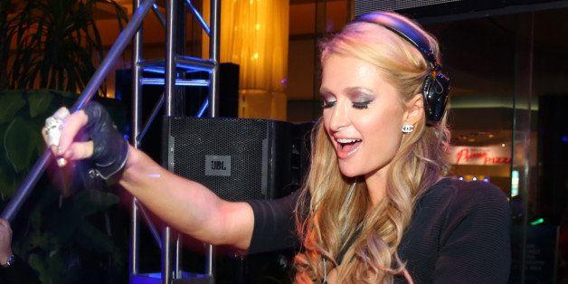 ATLANTIC CITY, NJ - FEBRUARY 01:  Paris Hilton DJ's at The Pool After Dark at Harrah's Resort on Saturday February 1, 2014 in
