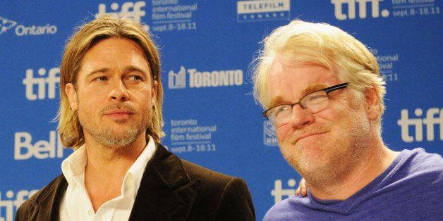 TORONTO, ON - SEPTEMBER 09:  Actors Jonah Hill, Brad Pitt and Philip Seymour Hoffman speak onstage at 'Moneyball' Press Confe