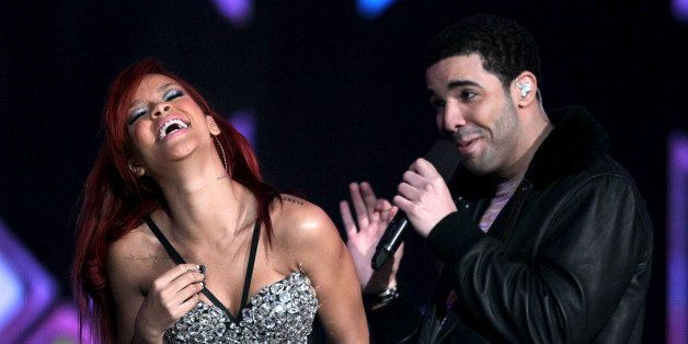 LOS ANGELES, CA - FEBRUARY 20:  Singer Rihanna (L) and rapper Drake perform during the 2011 NBA All-Star game halftime show a