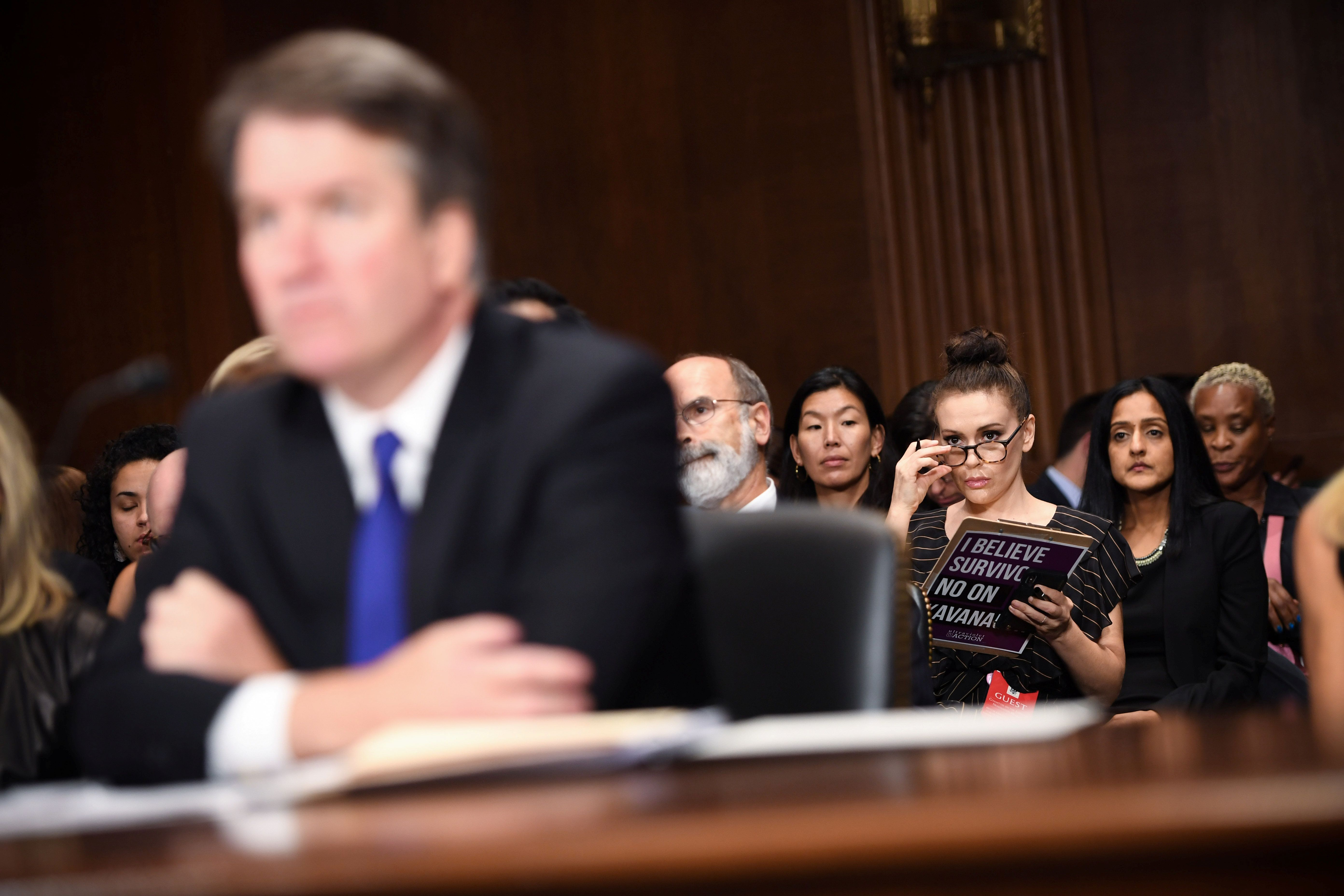 Actress Alyssa Milano listens to Supreme Court nominee Brett Kavanaugh as he testifies before the Senate Judiciary Committee on Capitol Hill in Washington, DC, U.S., September 27, 2018. Saul Loeb/Pool via REUTERS