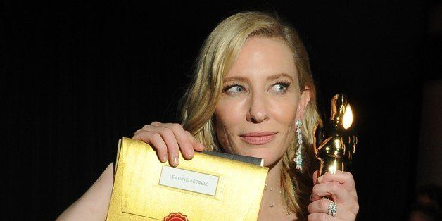 Winner for Best Actress in 'Blue Jasmine' Cate Blanchett poses with her trophy at the Governor's Ball following the 86th Acad