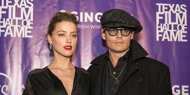 AUSTIN, TX - MARCH 06:  Actors Amber Heard and Johnny Depp arrive at The Texas Film Hall Of Fame Awards presented by the Aust