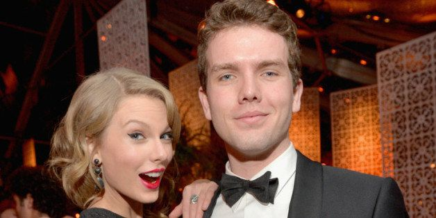 BEVERLY HILLS, CA - JANUARY 12:   Singer Taylor Swift (L) and Austin Swift attend The Weinstein Company & Netflix's 2014 Gold