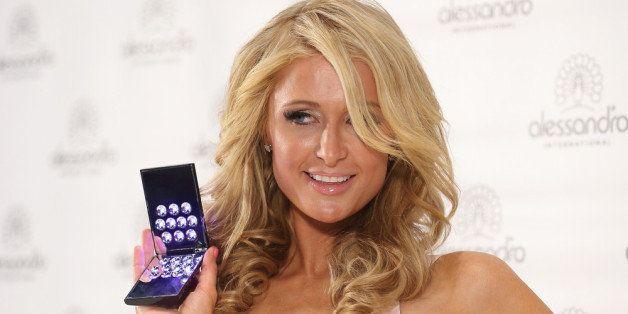 DUSSELDORF, GERMANY - MARCH 21:  Paris Hilton attends the Alessandro International Striplac presentation at Beauty Internatio