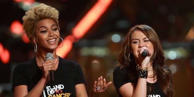 NEW YORK - SEPTEMBER 05:  Singers Beyonce and Miley Cyrus perform on stage during the Conde Nast Media Group's Fifth Annual F