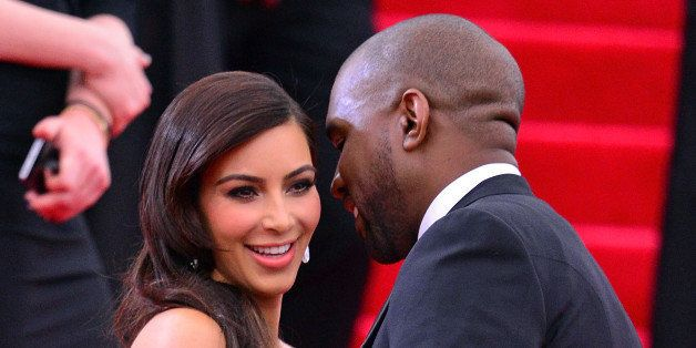 NEW YORK, NY - MAY 05:  Kim Kardashian and Kanye West attend the 'Charles James: Beyond Fashion' Costume Institute Gala at th