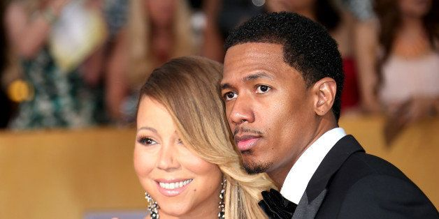 LOS ANGELES, CA - JANUARY 18: Mariah Carey and Nick Cannon (R) arrive at the 20th Annual Screen Actors Guild Awards at the Sh
