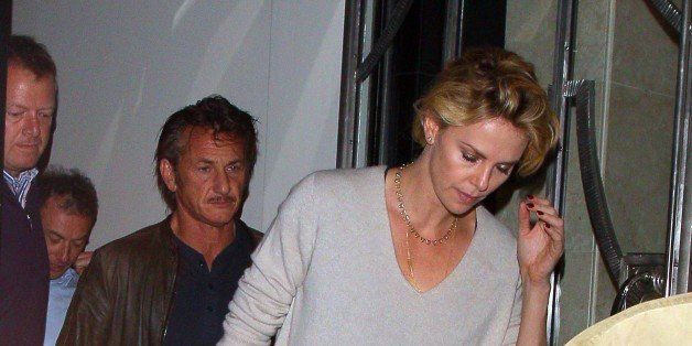 LONDON, UNITED KINGDOM - MAY 28: Charlize Theron and Sean Penn leaving Claridges Hotel on May 28, 2014 in London, England. (P