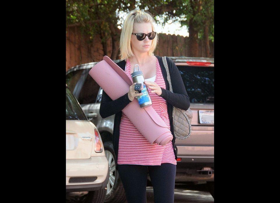 Mom-to-be actress January Jones is pretty in pink as she heads to her yoga class in Silver Lake, California on June 21st.
