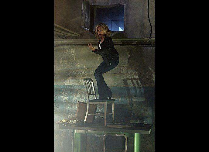 """Karma To Burn""--Julie Finlay (Elisabeth Shue) motions for someone to come to her as she stands on a chair in an attempt to c"