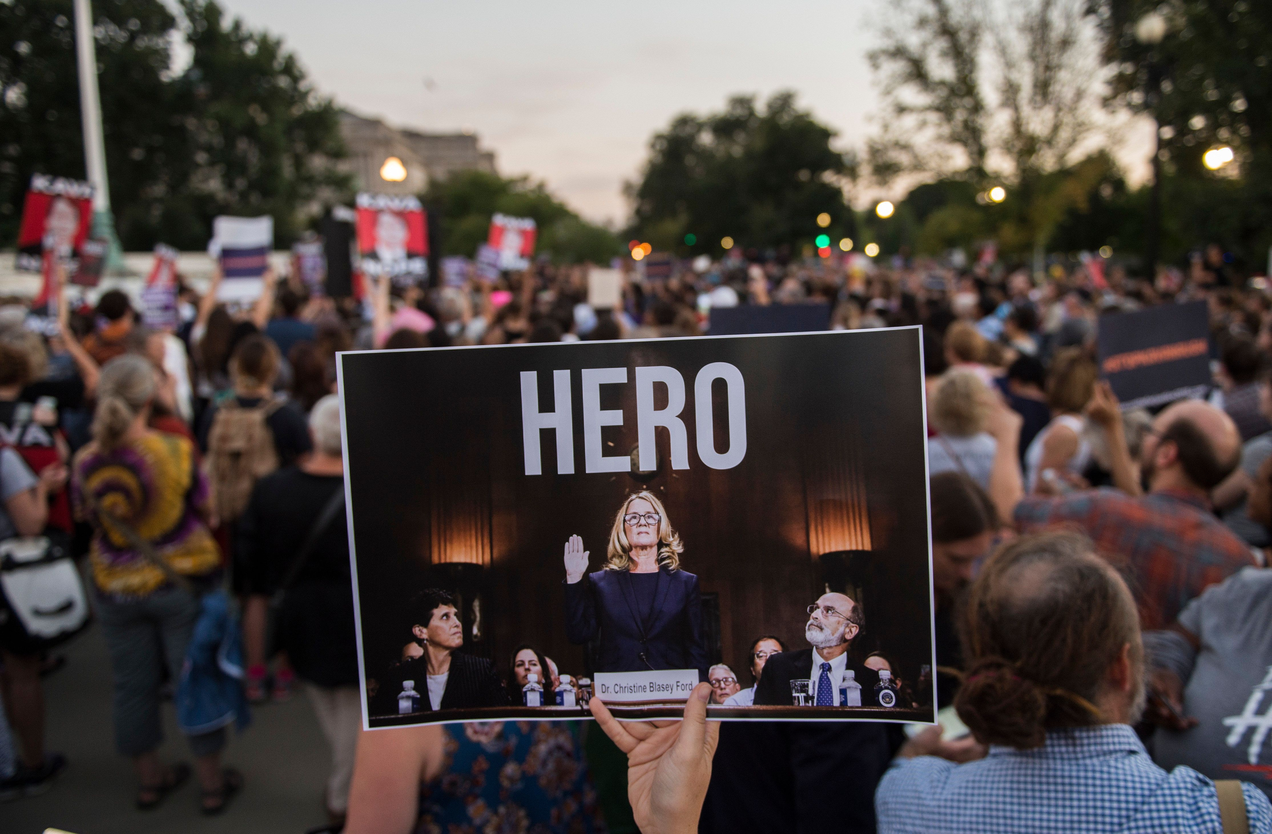 Activists take part in a protest against US Supreme Court nominee Brett Kavanaugh in Washington, DC, on October 3, 2018. (Photo by ANDREW CABALLERO-REYNOLDS / AFP)        (Photo credit should read ANDREW CABALLERO-REYNOLDS/AFP/Getty Images)