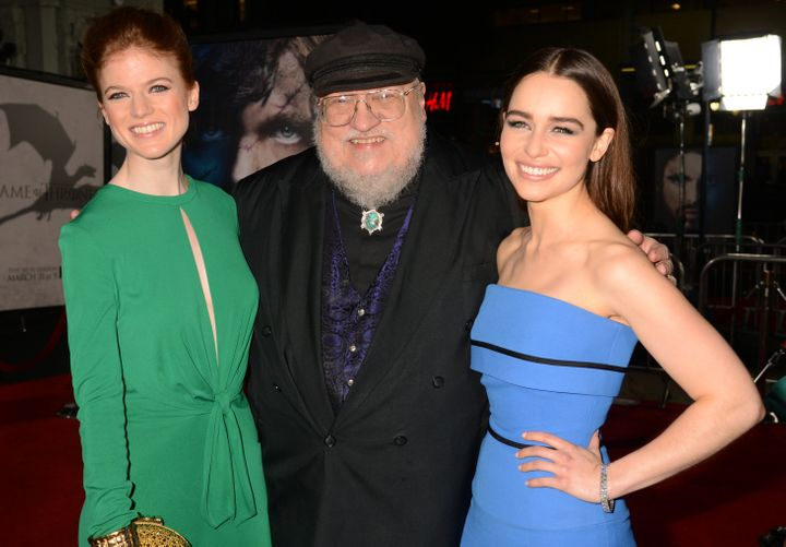 HOLLYWOOD, CA - MARCH 18:  Writer George R.R. Martin, center, actress Emilia Clarke, right, and actress Rose Leslie arrives t