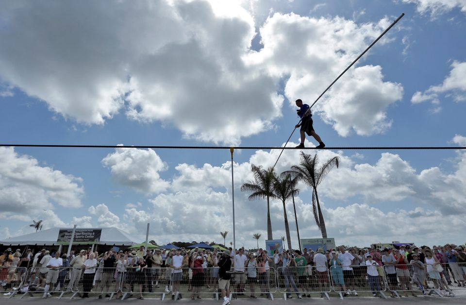 A large crowd watches as high wire performer Nik Wallenda walks across a wire as he practices Tuesday, June 18, 2013 in Saras
