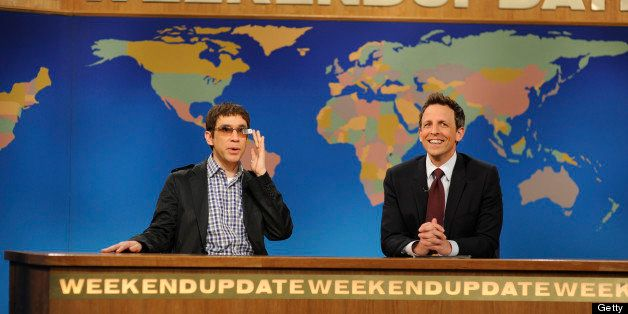 SATURDAY NIGHT LIVE -- 'Zach Galifianakis' Episode 1639 -- Pictured: (l-r) Fred Armisen with Seth Meyers during a skit on May