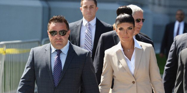 NEWARK, NJ - AUGUST 14:  Giuseppe 'Joe' Giudice (L) and wife Teresa Giudice leave court after facing charges of defrauding le