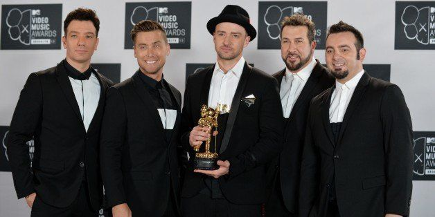 A reunited 'N Sync including Justin Timberlake (C), JC Chasez (L), Lance Bass (2nd L), Joey Fatone (2nd R), and Chris Kirkpat