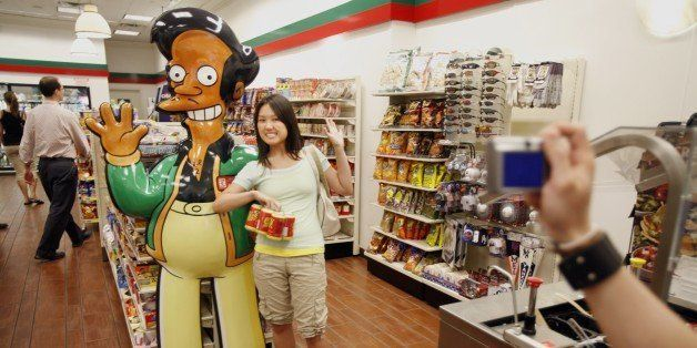 NEW YORK - JULY 2:  Mandy Lui (C) of Toronto poses with larger than life 'Apu' from the television cartoon show 'The Simpsons