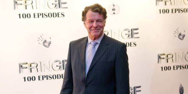 VANCOUVER, CANADA - DECEMBER 01:  John Noble poses for a photo on the red carpet while attending 'Fringe' celebrates 100 epis