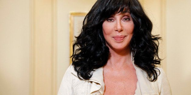 US singer and actress Cher poses on October 10, 2013 in Paris.    AFP PHOTO FRANCOIS GUILLOT        (Photo credit should read