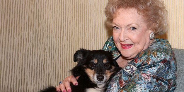 BEVERLY HILLS, CA - OCTOBER 5: Hero Dog Cassidy (L) and actress Betty White (R) pose during the American Humane Association H