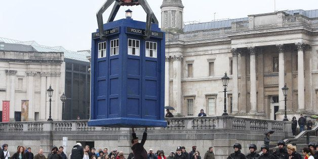 LONDON, ENGLAND - APRIL 09:  Matt Smith stands beneath a suspended Tardis during filming of Dr Who, in Trafalgar Square on Ap