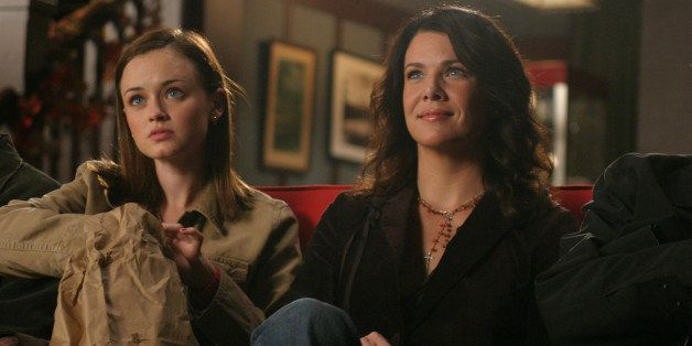 UNSPECIFIED - SEPTEMBER 28:  Medium shot of Alexis Bledel as Rory sitting on couch with Lauren Graham as Lorelai.  (Photo by