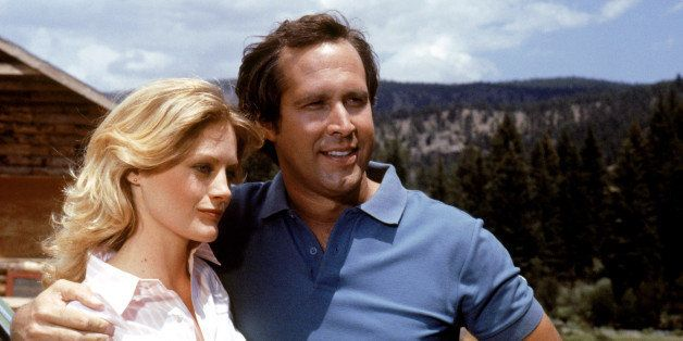 UNSPECIFIED - JULY 24:  Medium shot of Chevy Chase as Clark Griswold with arm around Beverly D'Angelo as Ellen Griswold.  (Ph