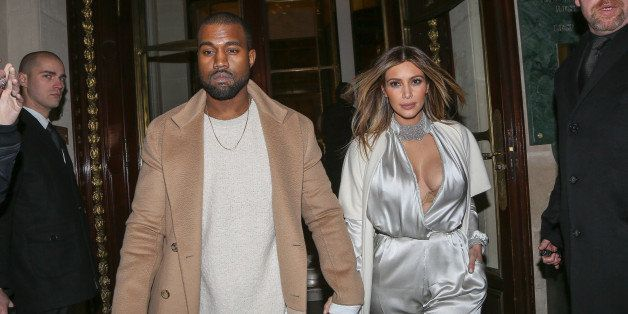 PARIS, FRANCE - JANUARY 21:  Kanye West and Kim Kardashian leave the 'Meurice' hotel on January 21, 2014 in Paris, France.  (
