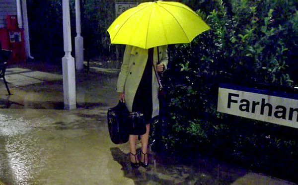 """Baker kept three of the same yellow umbrellas, purchased at Nordstrom, on hand throughout the show. """"The only thing Carter Ba"""