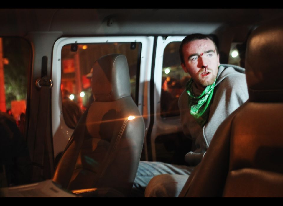NEW YORK, NY - OCTOBER 26:  A bloody Occupy Wall Street protester sits in a police van after being arrested during a demonstr