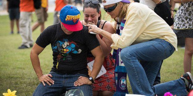 ORLANDO, FL - JUNE 13: (L to R) Jimaida Arrieta and Jessica Ellison cry at a makeshift memorial prior...